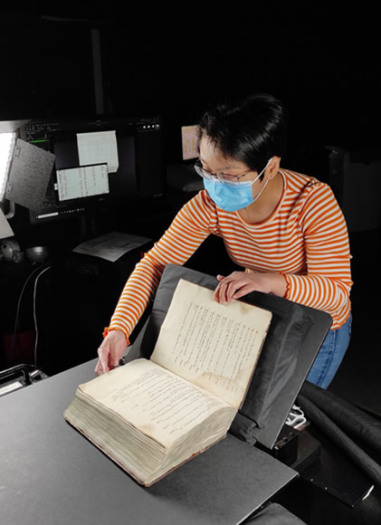 iGuana Employee Digitizes Medieval Manuscript - Book for Mmmonk Project Using Custom Qidenus Scanner Installation